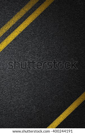 Level asphalted road with a dividing yellow stripes. The texture of the tarmac, top view. - stock photo