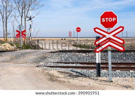 Level crossing with no barrier in Toledo Province, Spain - stock photo
