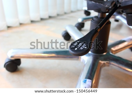 Lever adjustable chair. - stock photo
