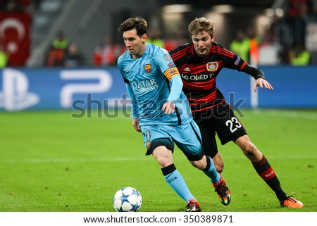 Leverkusen, Germany- December 9, 2015: Christoph Kramer (R) and Lionel Messi (L) during the UEFA Champions League game between Bayer 04 Leverkusen vs Barcelona at BayArena stadium - stock photo