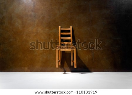 levitating a chair against the wall