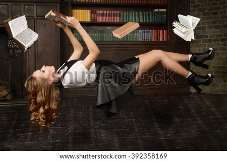 Levitating woman in the classical library room - stock photo