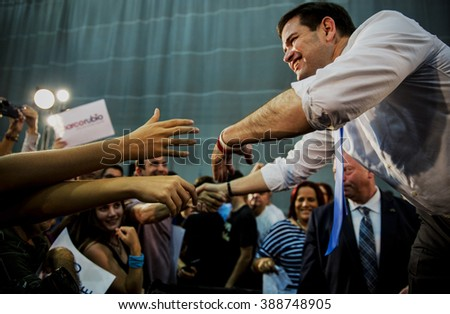 Levittown, Puerto Rico - March 5, 2016: Republican presidential candidate, Marco Rubio, shakes hands with a supporter at a rally in Puerto Rico on the eve of the Republican primary on the island. - stock photo