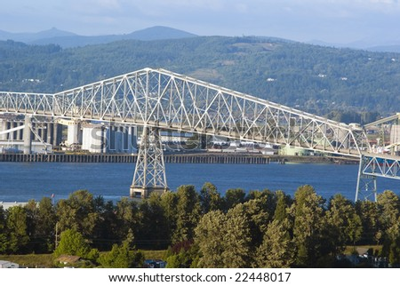 Lewis and Clark Bridge over Columbia river and industrial zone - stock photo
