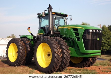LEXINGTON, KY-CIRCA JANUARY, 2015: John Deere tractor on display.  Large agribusinesses increasingly turn to large equipment like this to help produce record crop yields.   - stock photo
