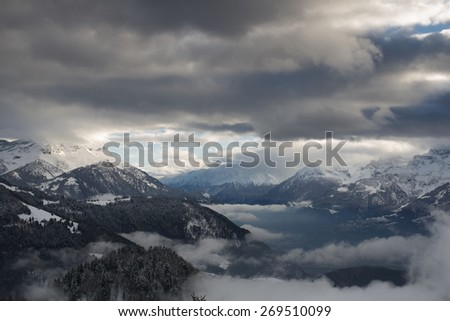 LEYSIN, SWITZERLAND - 29 DECEMBER 2013 : gorgeous view to sunset mountains in the resort town on Leysin in the Swiss Alps. - stock photo