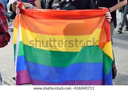LGBT Flag. Parade on the street. Human rights.