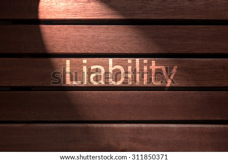 liability text on wooden - stock photo