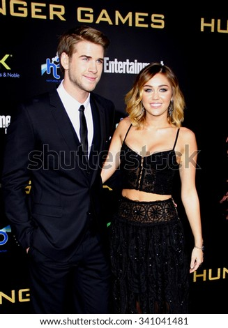 "Liam Hemsworth and Miley Cyrus at the Los Angeles Premiere of ""The Hunger Games"" held at the Nokia Theatre L.A. Live, California, United States on March 12, 2012.   - stock photo"