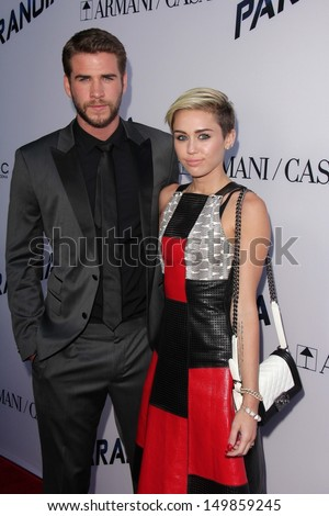 "Liam Hemsworth and Miley Cyrus at the ""Paranoia"" US Premiere, Directors Guild of America, Los Angeles, CA 08-08-13 - stock photo"