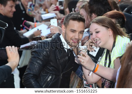 Liam Payne from One Direction arriving at the UK Premiere of 'One Direction, This Is Us' at the Empire Leicester Square, London. 20/08/2013 - stock photo