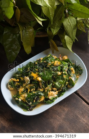 liang leaves fried with eggs, delicious fried vegetable of thai southern food. - stock photo