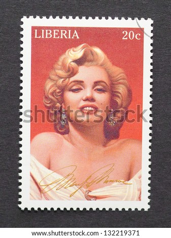 LIBERIA - CIRCA 1996: a postage stamp printed in Liberia showing an image of Marilyn Monroe, circa 1996. - stock photo