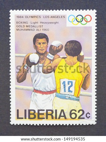 LIBERIA - CIRCA 1984: a postage stamp printed in Liberia showing an image of the olympic athlete gold medal winner Muhammad Ali or Cassius Clay, circa 1984.  - stock photo