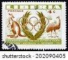 LIBERIA - CIRCA 1956: a stamp printed in the Liberia shows Kangaro and Emu, 1956 Summer Olympic Games, Melbourne, circa 1956 - stock photo
