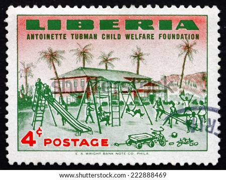 LIBERIA - CIRCA 1957: a stamp printed in the Liberia shows Orphanage and Orphanage Playground, Founding of the Antoinette Tubman Child Welfare Foundation, circa 1957 - stock photo