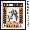 LIBERIA - CIRCA 1955: a stamp printed in the Liberia shows Soccer Players in Action, Sport, circa 1955 - stock photo