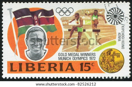 LIBERIA - CIRCA 1973: stamp printed by Liberia, shows Gold medal winners in 20th Olympic Games, Kipchoge Keino, Kenya, 3000-meter steeplechase, circa 1973