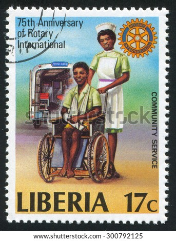 LIBERIA - CIRCA 1979: stamp printed by Liberia, shows Rotary emblem, man in wheelchair and nurse, circa 1979 - stock photo