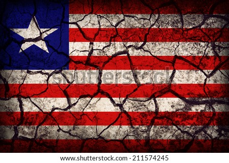 Liberia flag pattern on the crack soil texture ,retro vintage style - stock photo