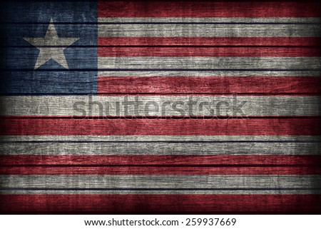Liberia flag pattern on wooden board texture ,retro vintage style - stock photo