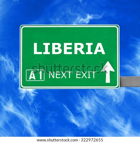 LIBERIA road sign against clear blue sky