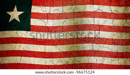 Liberian flag on a cracked grunge background - stock photo