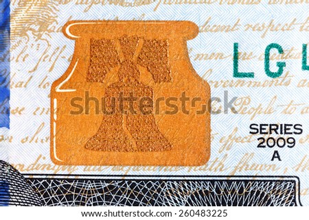 Liberty Bell â?? U.S. currency one hundred dollar bill. - stock photo
