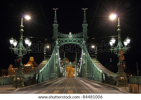 Liberty bridge in Budapest, illuminated at night. - stock photo