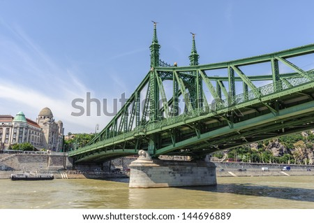 Liberty Bridge (sometimes Freedom Bridge) in Budapest, Hungary, connects Buda and Pest across the River Danube.