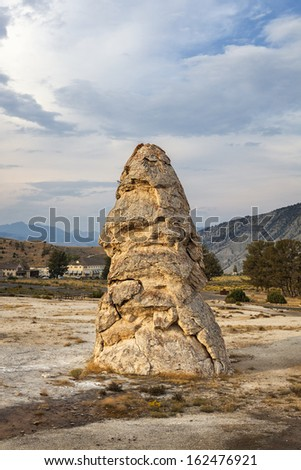 Liberty Cap is a dormant hot spring cone in Mammoth Hot Springs, Yellowstone National Park, Wyoming - stock photo