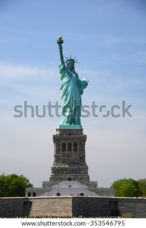 Liberty Statue, a landmark of new york city, with blue sky