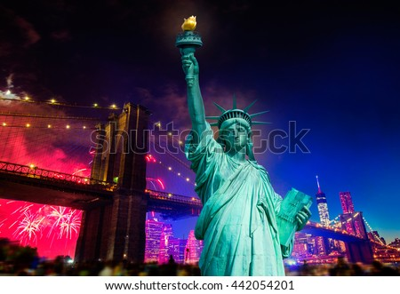 Liberty Statue and Brooklyn bridge on july 4 th fireworks New York America photomount - stock photo