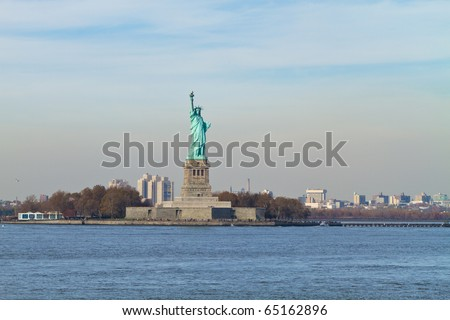 Liberty Statue at Sunset with red sky in Manhattan - stock photo