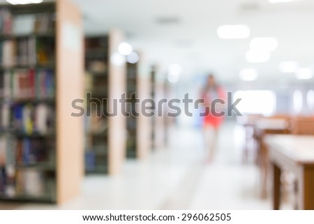 library blur background with student and bookshelf - stock photo