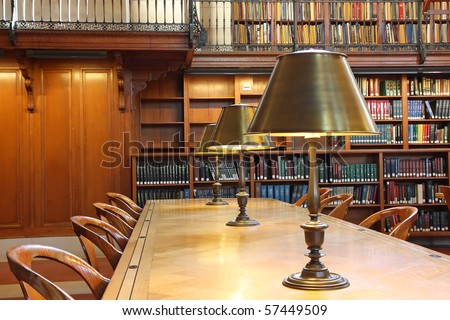 Library desk with lamp - stock photo