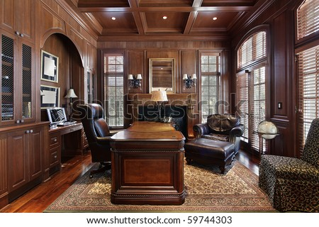 Library in luxury home with large desk - stock photo
