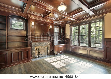 Library in luxury new construction home with fireplace - stock photo