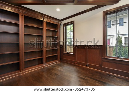 Library in new construction home with wood ceiling beam - stock photo