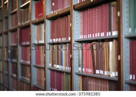 Library service; shelves full of books - stock photo