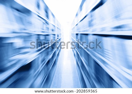 library setting with books and reading material - stock photo