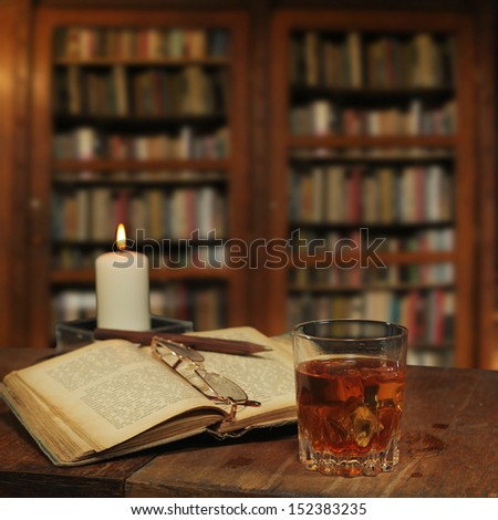 library setting with old books  - stock photo