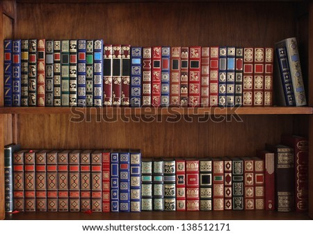 Library shelves full of old books - stock photo