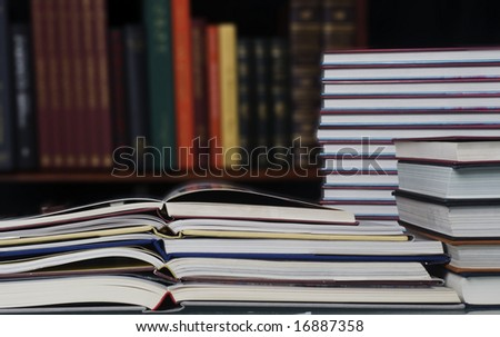 Library stack of books - stock photo