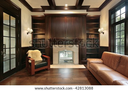 Library with marble fireplace - stock photo