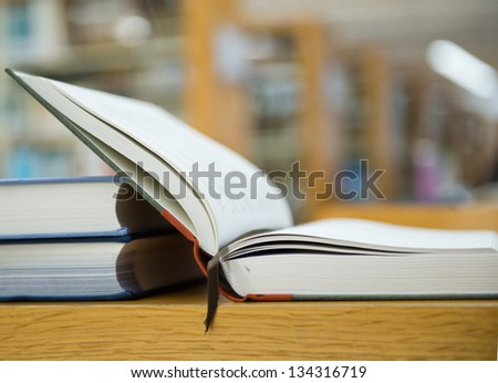 library with stack of books opened. - stock photo