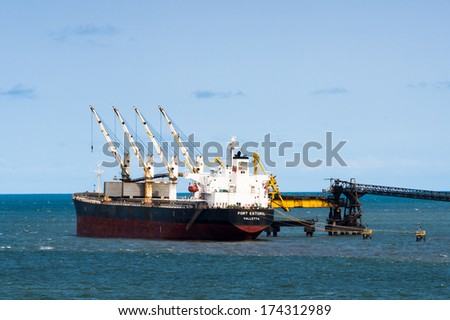 LIBREVILLE, GABON - MAR 6, 2013: Cargo ship near the port of Libreville. Port of Libreville is a trade center for a timber region.