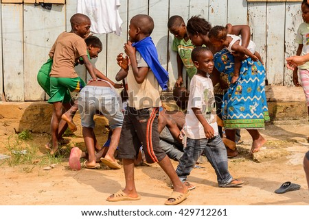 LIBREVILLE, GABON - MAR 6, 2013: Unidentified Gabonese children play in the street in Gabon, Mar 6, 2013. People of Gabon suffer of poverty due to the unstable economical situation
