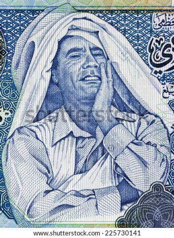 LIBYA - CIRCA 2004: Muammar Gaddafi (1942-2011) on 1 Dinar 2004 Banknote from Libya. Ruler of Libya during 1969-2011. - stock photo