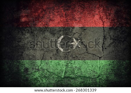 Libya flag pattern on dirty old concrete wall texture ,retro vintage style - stock photo